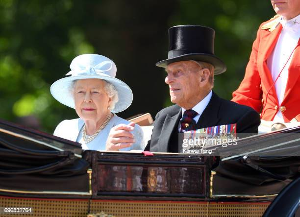 Queen Elizabeth II and Prince Philip Duke of Edinburgh ride by carriage during the annual Trooping The Colour parade at the Mall on June 17 2017 in...