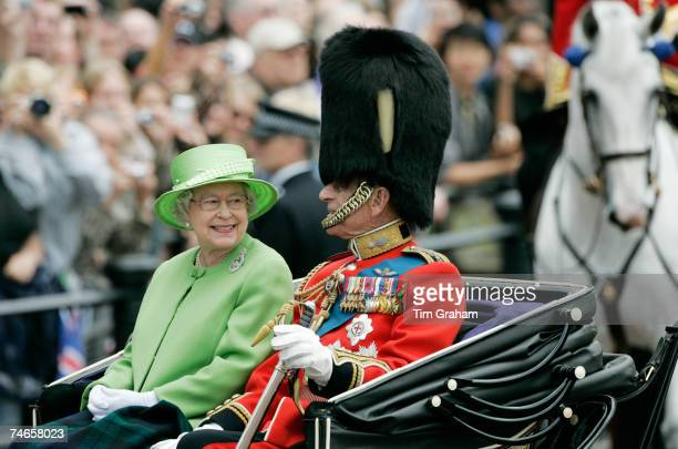 Queen Elizabeth II and Prince Philip Duke of Edinburgh ride in the carriage procession at Trooping the Colour on June 16 2007 in London England
