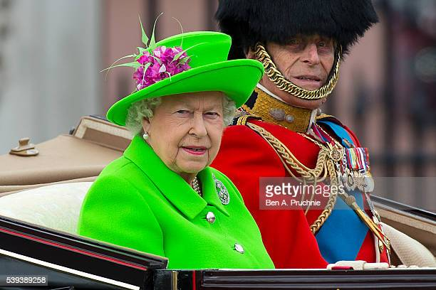 Queen Elizabeth II and Prince Philip, Duke of Edinburgh sit in a carriage during the Trooping the Colour, this year marking the Queen's 90th birthday...