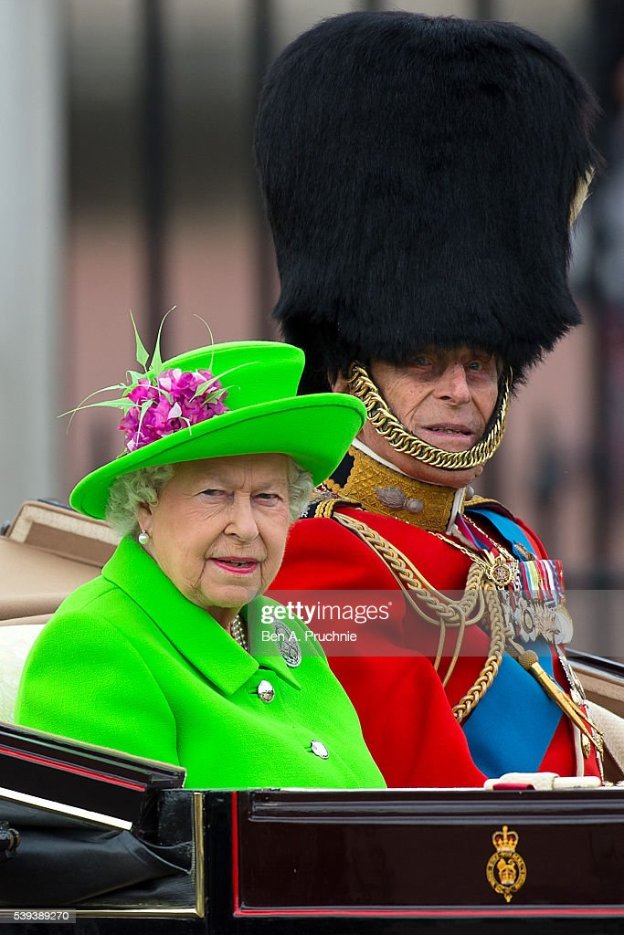 Queen Elizabeth II and Prince Philip, Duke of Edinburgh sit in a carriage during the Trooping the Colour, this year marking the Queen's 90th birthday at The Mall on June 11, 2016 in London, England. The ceremony is Queen Elizabeth II's annual birthday parade and dates back to the time of Charles II in the 17th Century when the Colours of a regiment were used as a rallying point in battle.