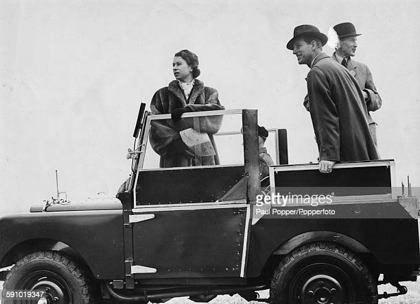 Queen Elizabeth II and Prince Philip, Duke of Edinburgh stand in the back of a Land Rover as they inspect the course at Larkhill prior to the United...