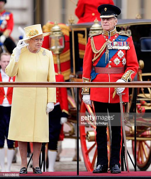 Queen Elizabeth II and Prince Philip Duke of Edinburgh stand on a dias to review the troops during the annual Trooping the Colour Ceremony at...