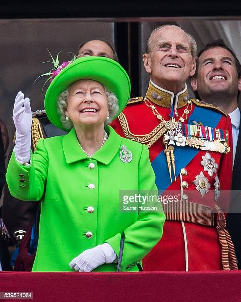Queen Elizabeth II and Prince Philip, Duke of Edinburgh stand on the balcony during the Trooping the Colour, this year marking the Queen's official...