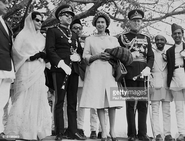 Queen Elizabeth II and Prince Philip Duke of Edinburgh stand together King Mahendra of Nepal and Queen Ratna of Nepal after their arrival in...