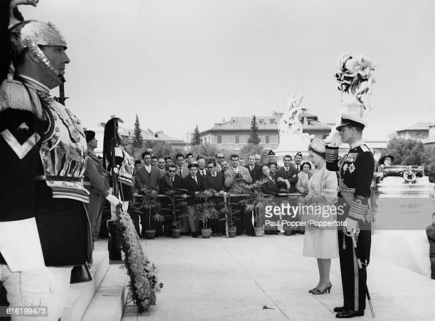 Queen Elizabeth II and Prince Philip, Duke of Edinburgh stand together as the Prince takes the salute during a wreath laying ceremony in the...