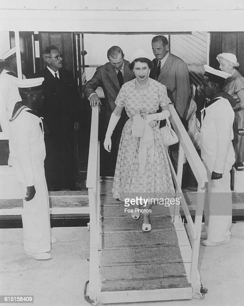 Queen Elizabeth II and Prince Philip Duke of Edinburgh stepping off the yacht 'Wilhemina' at Mangrove Bay Bermuda during their Commonwealth Tour 24th...