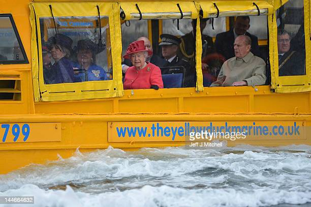 Queen Elizabeth II and Prince Philip Duke of Edinburgh take a ride on the Yellow Duck and amphibious vehicle during a visit to Merseyside Maritime...