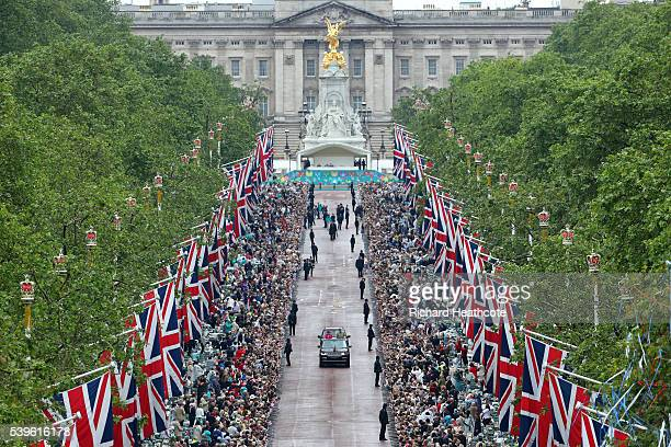Queen Elizabeth II and Prince Philip Duke of Edinburgh take part in a parade down The Mall during 'The Patron's Lunch' celebrations for The Queen's...