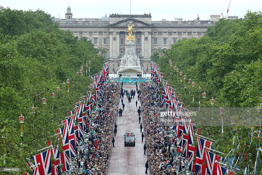 Queen Elizabeth II and Prince Philip, Duke of Edinburgh take part in a parade down The Mall during 'The Patron's Lunch' celebrations for The Queen's 90th birthday on June 12, 2016 in London, England.