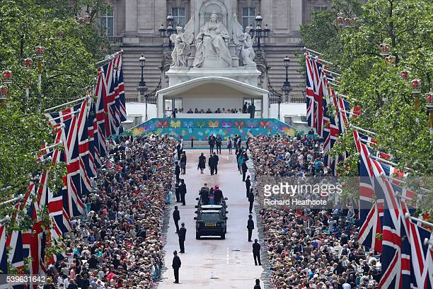 Queen Elizabeth II and Prince Philip, Duke of Edinburgh take part in a parade down The Mall during 'The Patron's Lunch' celebrations for The Queen's...