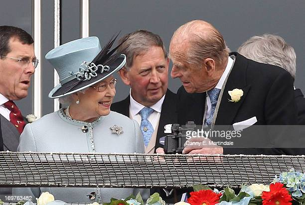 Queen Elizabeth II and Prince Philip Duke of Edinburgh talk during Derby Day at The Derby Festival on June 1 2013 in Epsom United Kingdom