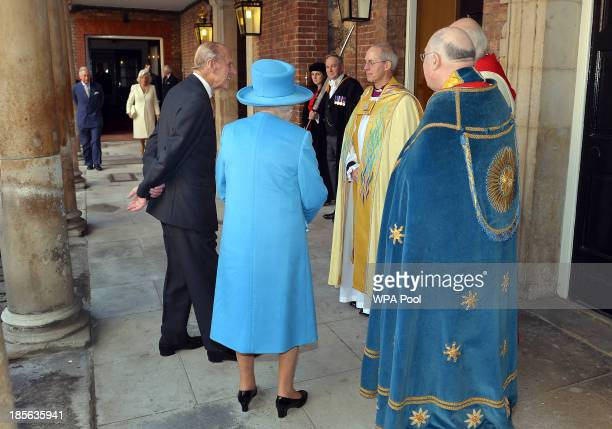 Queen Elizabeth II and Prince Philip, Duke of Edinburgh talk to the Archbishop of Canterbury, Justin Welby as they arrive for the the christening of...