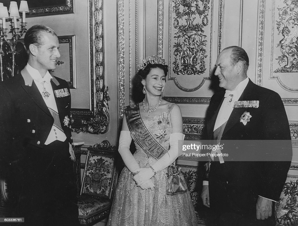 Queen Elizabeth II and Prince Philip, Duke of Edinburgh (left) talk with King Olav V of Norway (1903-1991) following the King's investiture as a Knight Companion of the Order of the Garter at Windsor Castle, England, May 29th 1959.