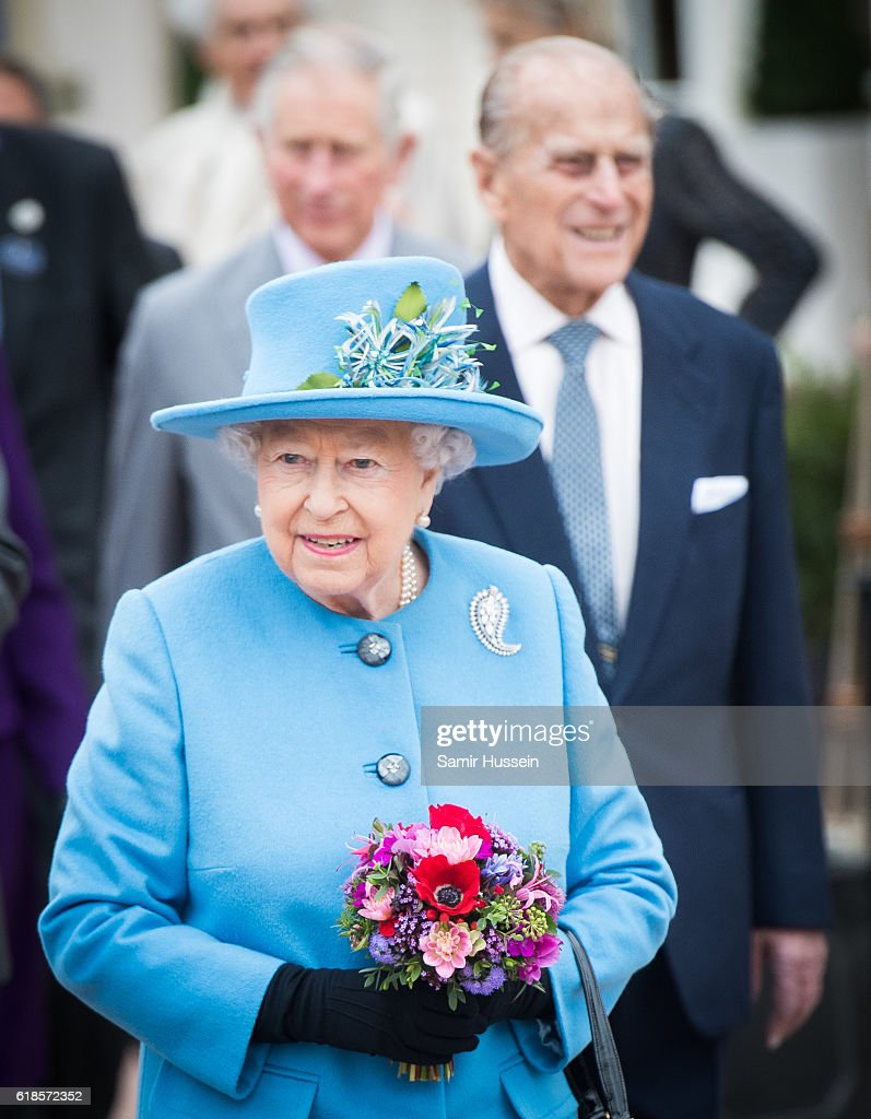 Queen Elizabeth II and Prince Philip, Duke of Edinburgh tour Queen Mother Square on October 27, 2016 in Poundbury, Dorset.