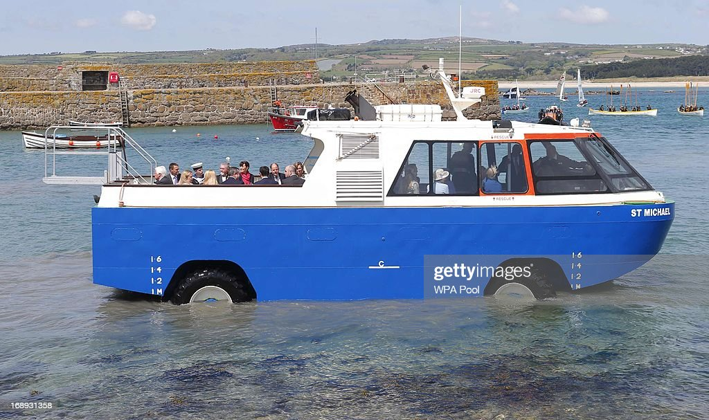 Queen Elizabeth II and Prince Philip, Duke of Edinburgh travel by an amphibious vehicle to visit St Michael's Mount, off the coast of Cornwall on May 17, 2013 in south west England. Emily is the daughter of Gary Earrly, head of Cornish Heritage Builders, and was invited to receive the Queen and Duke of Edinburgh by the St Aubyn family who live on the island.