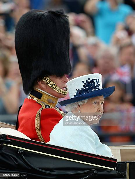 Queen Elizabeth II and Prince Philip Duke of Edinburgh travel by carriage during Trooping the Colour Queen Elizabeth II's Birthday Parade at The...