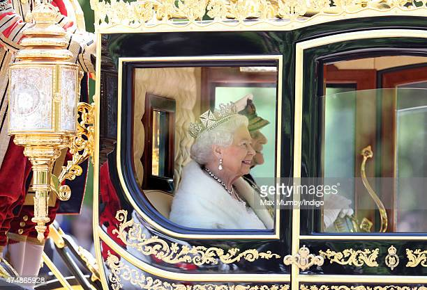 Queen Elizabeth II and Prince Philip Duke of Edinburgh travel down The Mall in the Diamond Jubilee State Coach after attending the State Opening of...