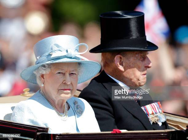 Queen Elizabeth II and Prince Philip Duke of Edinburgh travel down The Mall in a horse drawn carriage during the annual Trooping the Colour Parade on...