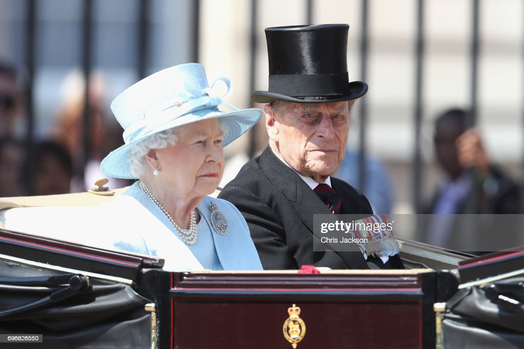Queen Elizabeth II and Prince Philip, Duke of Edinburgh travel in the royal carriage during the annual Trooping The Colour parade on June 17, 2017 in London, England.