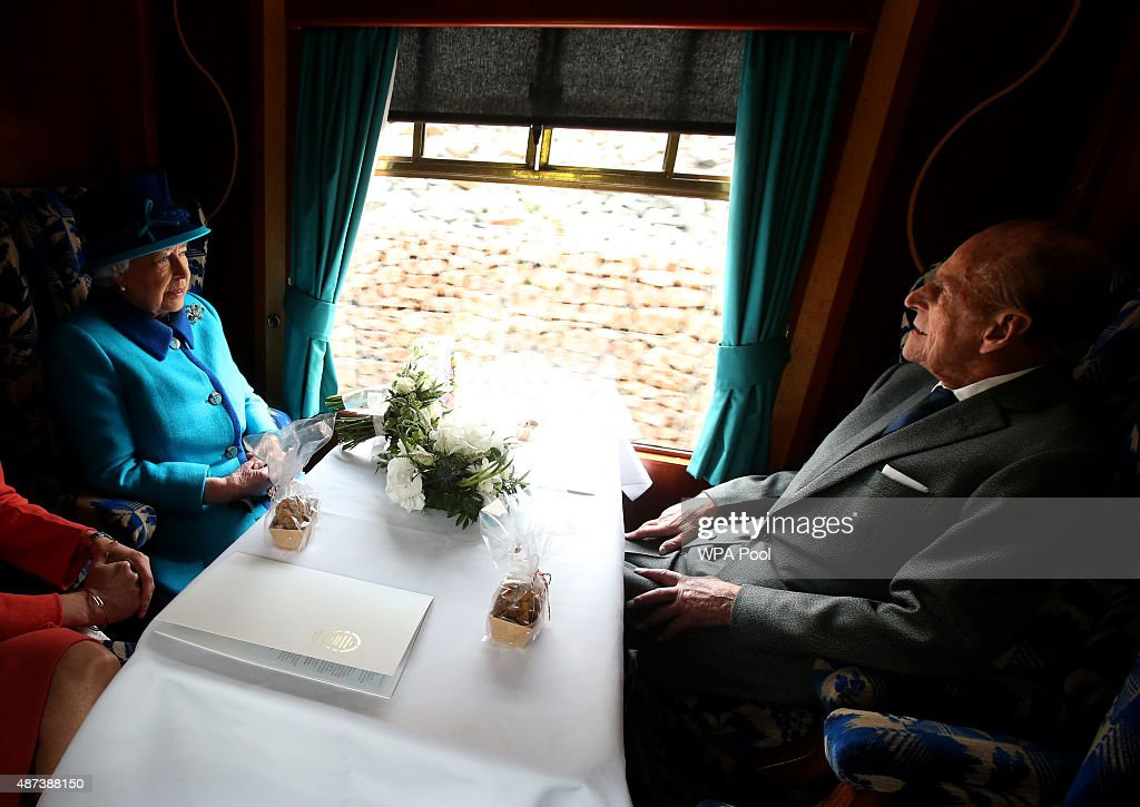 Queen Elizabeth II and Prince Philip, Duke of Edinburgh, travel on a steam train to inaugurate the new £294 million Scottish Borders Railway, on the day the Queen becomes Britain's longest reigning monarch, on September 9, 2015 in Tweedbank, England.
