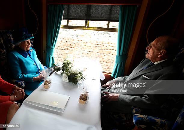 Queen Elizabeth II and Prince Philip, Duke of Edinburgh, travel on a steam train to inaugurate the new £294 million Scottish Borders Railway, on the...