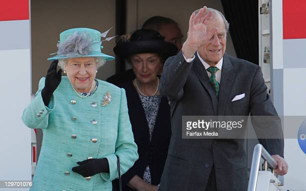 Queen Elizabeth II and Prince Philip, Duke of Edinburgh upon arrival at the Canberra at Defence Establishment Fairbairn on October 19, 2011 in...