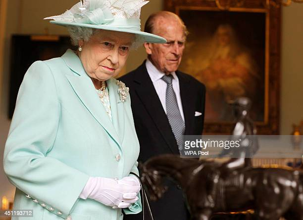 Queen Elizabeth II and Prince Philip Duke of Edinburgh visit Hillsborough Castle during filming of Antiques Roadshow on the third and final day of...