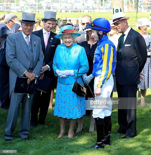 Queen Elizabeth II and Prince Philip Duke of Edinburgh visit the parade ring as they arrive at the Woodbine Racetrack for 151st Running of The...