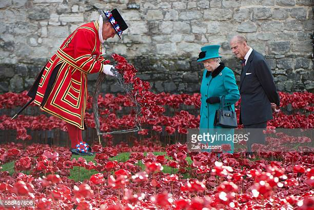 Queen Elizabeth II and Prince Philip, Duke of Edinburgh visit the Tower of London to view the Blood Swept Lands and Seas of Red evolving art...