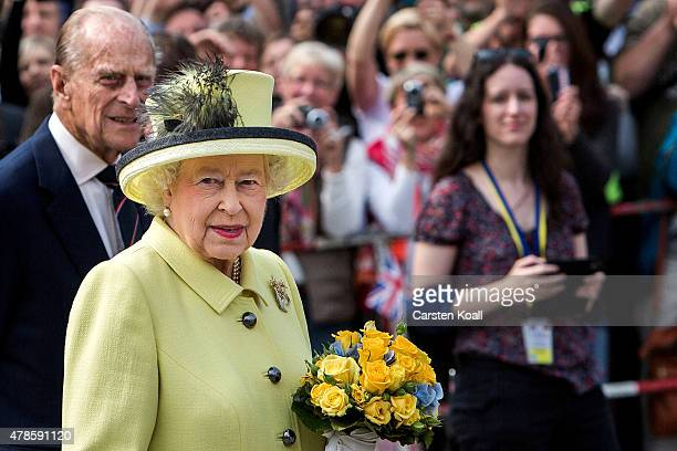 Queen Elizabeth II and Prince Philip Duke of Edinburgh visit the Brandenburg Gate on the final day of a four day state visit to Germany on June 26...