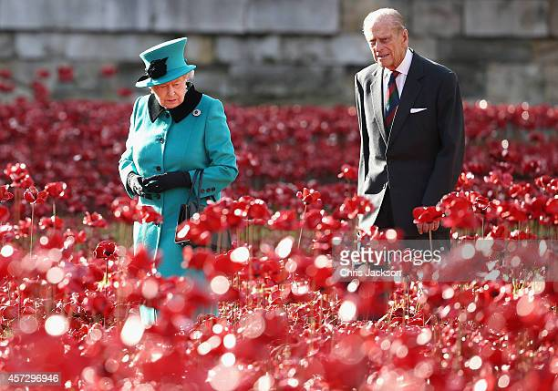 Queen Elizabeth II and Prince Philip Duke of Edinburgh visit the Blood Swept Lands and Seas of Red evolving art installation at the Tower of London...