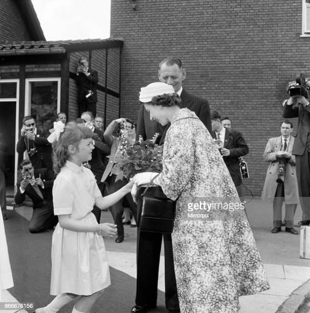 Queen Elizabeth II and Prince Philip Duke of Edinburgh visit to Denmark Queen Elizabeth receives a bouquet from a girl 22nd May 1957
