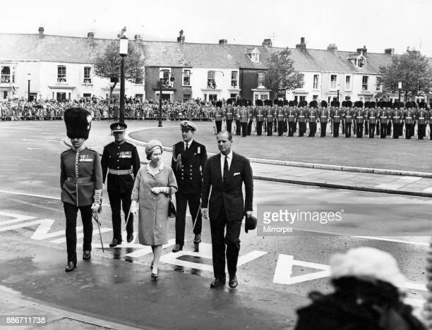 Queen Elizabeth II and Prince Philip Duke of Edinburgh walk back to the Guildhall Swansea after the Queen had inspected the Guard of Honour mounted...