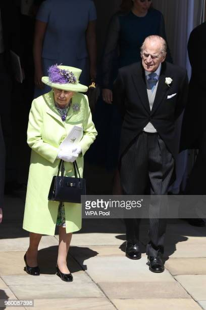 Queen Elizabeth II and Prince Philip, Duke of Edinburgh walk through the Galilee Porch after the wedding of Prince Harry and Meghan Markle at St...