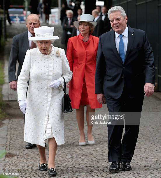 Queen Elizabeth II and Prince Philip, Duke of Edinburgh walk to the bank of the River Spree to travel by boat to the Chancellery with Germany...