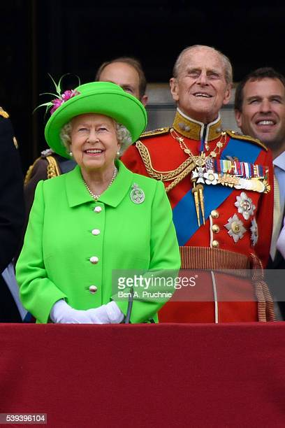 Queen Elizabeth II and Prince Philip, Duke of Edinburgh watch a fly past during the Trooping the Colour, this year marking the Queen's 90th birthday...