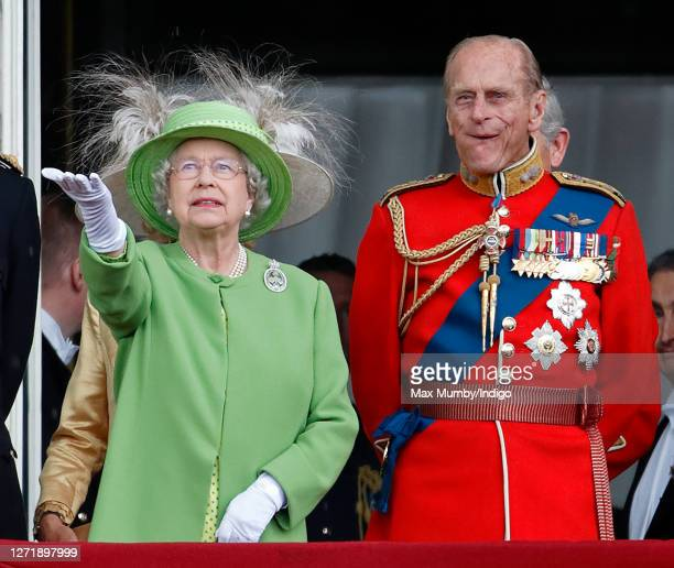 Queen Elizabeth II and Prince Philip Duke of Edinburgh watch a flypast from the balcony of Buckingham Palace during the annual Trooping the Colour...
