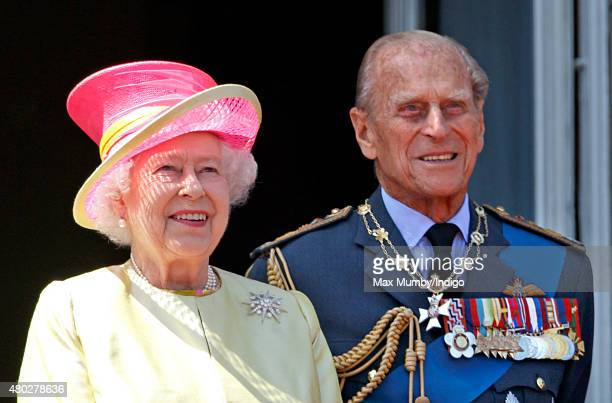 Queen Elizabeth II and Prince Philip Duke of Edinburgh watch a flypast of Spitfire Hurricane aircraft from the balcony of Buckingham Palace to...