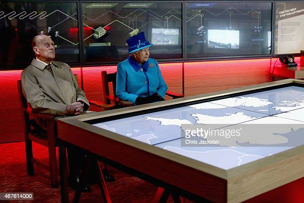 Queen Elizabeth II and Prince Philip Duke of Edinburgh watch a short film on the Battle of Britain as they visit the National Memorial to the Few to...