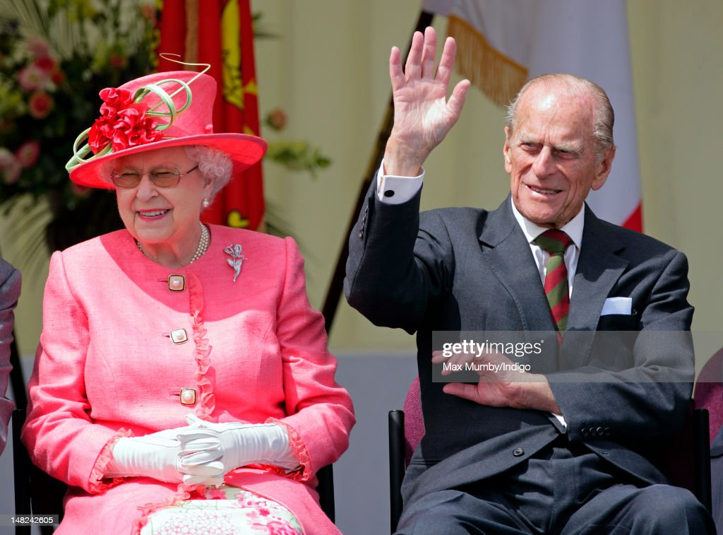 Queen Elizabeth II and Prince Philip, Duke of Edinburgh watch the Shropshire Diamond Jubilee Pageant during a visit to RAF Cosford as part of Queen Elizabeth II's Diamond Jubilee Tour of the UK on July 12, 2012 in Wolverhampton, England.
