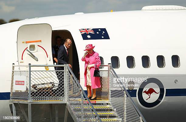 Queen Elizabeth II and Prince Philip Duke of Edinburgh wave as they board their flight at Melbourne Airport on October 26 2011 in Melbourne Australia...