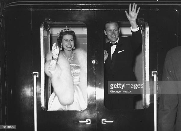 Queen Elizabeth II and Prince Philip the Duke of Edinburgh wave as they leave Liverpool after attending an ice show 'Snow White And The Seven Dwarfs'