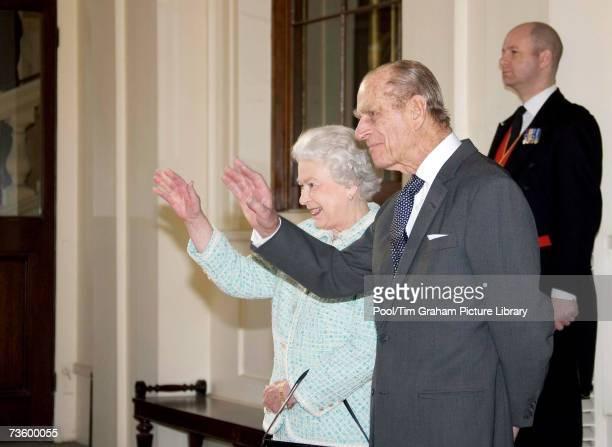 Queen Elizabeth II and Prince Philip Duke of Edinburgh wave farewell to the President of the Republic of Ghana John Agyekum Kufuor as he leaves...
