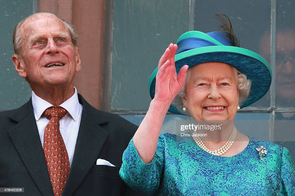 Queen Elizabeth II and Prince Philip, Duke of Edinburgh wave from the balcony of the city hall on June 25, 2015 in Frankfurt am Main, Germany. The Queen and Prince Philip have travelled to Frankfurt following a visit to Berlin. The Royal couple will also visit the concentration camp memorial at Bergen-Belsen during their trip, which is their first to Germany since 2004.