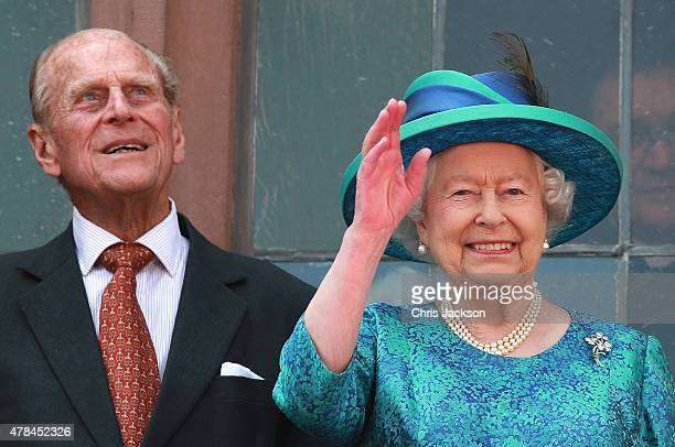 Queen Elizabeth II and Prince Philip, Duke of Edinburgh wave from the balcony of the city hall on June 25, 2015 in Frankfurt am Main, Germany. The...