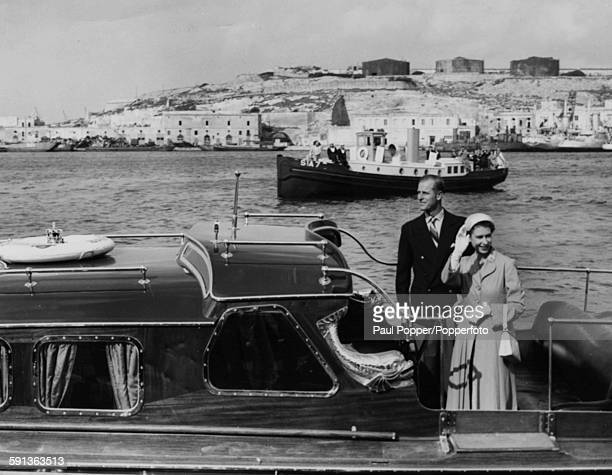 Queen Elizabeth II and Prince Philip Duke of Edinburgh wave from the Royal Barge as they depart from Malta on their tour of the Commonwealth May 8th...