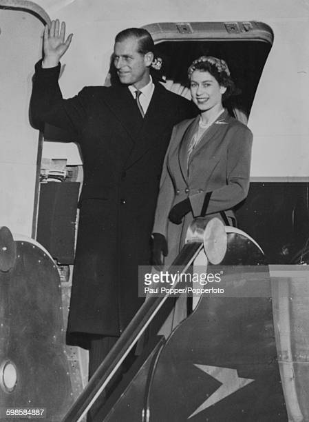 Queen Elizabeth II and Prince Philip Duke of Edinburgh wave from the door of the Royal Plane as they prepare to depart for Bermuda on the first leg...