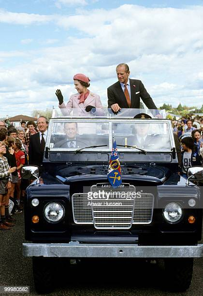 Queen Elizabeth II and Prince Philip, Duke of Edinburgh wave to wellwishers from their open Land Rover in Wellington, New Zealand, October 1981.