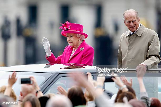 Queen Elizabeth II and Prince Philip Duke of Edinburgh wave to guests during 'The Patron's Lunch' celebrations for The Queen's 90th birthday at on...