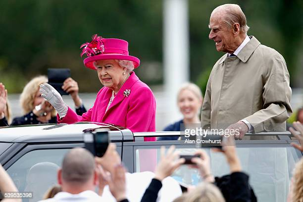Queen Elizabeth II and Prince Philip Duke of Edinburgh wave to guests during The Patron's Lunch celebrations for The Queen's 90th birthday at on June...